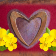 Love heart with yellow violets - Stock Photo
