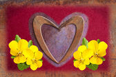 Love heart with yellow violets — Stock Photo