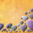 Royalty-Free Stock Photo: Yellow Valentinecard with purple heart