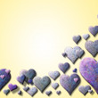 Yellow Valentinecard with purple heart — Stock Photo