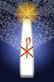 Easter candle with Christ monogram — Stock Photo