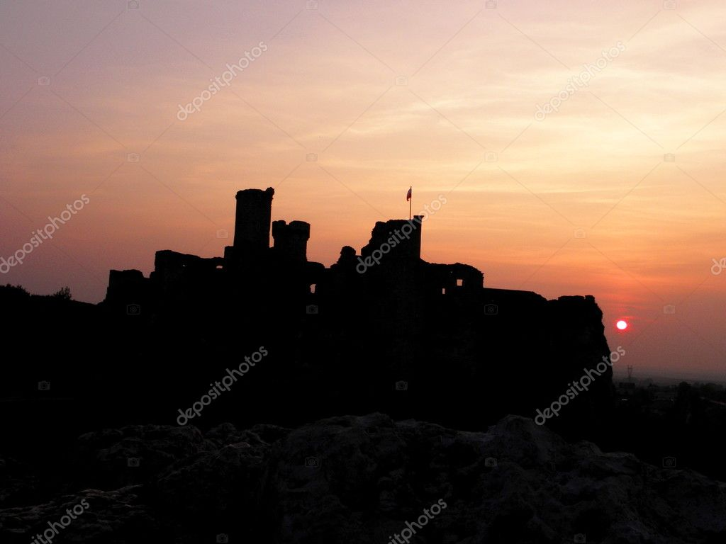 Castle with polish flag on sunset background — Stock Photo #8249972