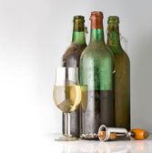 Three old bottles of wine — Stock Photo