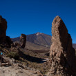 Rocky outcrops and Mt Teide summit - Stock Photo