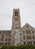 Statue and church — Stock Photo