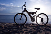 Silhouette of a Bike on the Beach — Stock Photo