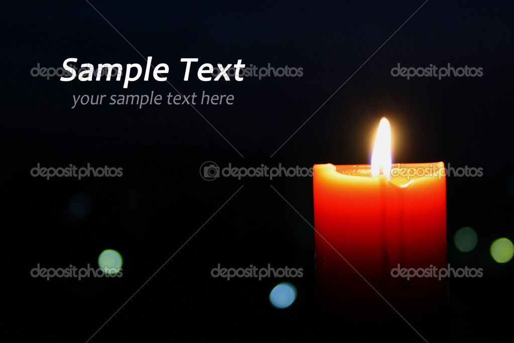 A single burning orange candle isolated  Foto de Stock   #9935714