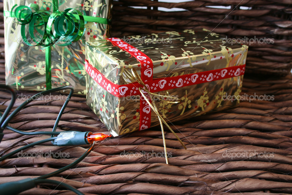 Two christmas gifts and one christmas light on a rustic background — Stock Photo #8154973