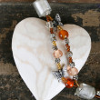 Heart and beads - Foto Stock