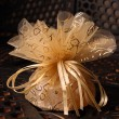 Golden Favour with ribbon - Stock Photo