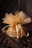 Golden Favour with ribbon — Stock Photo