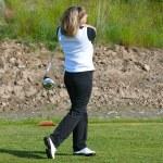 Female golfer — Stock Photo #8377377