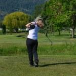 Female golfer — Stock Photo #8377387