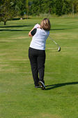 Female golfer — Stock fotografie