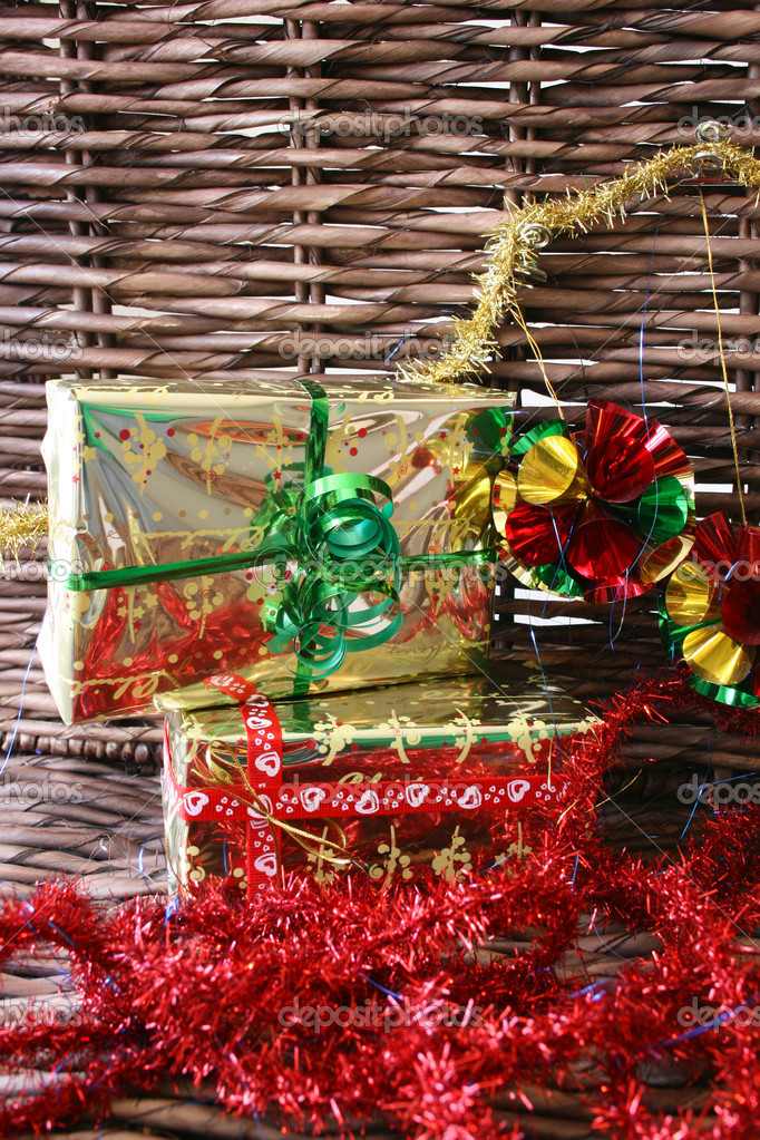 Christmas presents, tinsel and decorations on a rustic background — Foto Stock #9376739