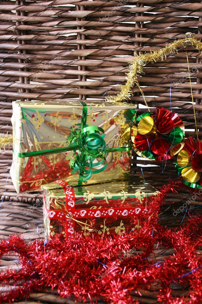 Christmas presents, tinsel and decorations on a rustic background — Stock fotografie #9376739