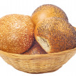 Buns with sesame and poppy seeds in  basket — Stock Photo