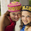 Two girls in skullcaps - Stock Photo