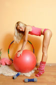 The blonde with the ball and hula hoop. — Stock Photo