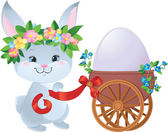 Easter Bunny with egg in a small cart — Stockvektor