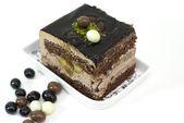 Piece of chocolate cake on white background — Stock Photo