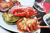 Red lobster with artichoke. — Stock Photo