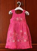 Baby pink dress on hanger. — Stock Photo