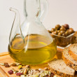 Jug of Olive Oil with Olives. — Stock Photo