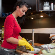 Young woman do the cleaning in kitchen - Stock Photo