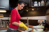 Young woman do the cleaning in kitchen — Stock Photo