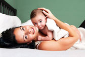 Happy woman with her baby — Stock Photo