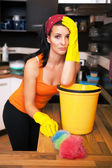 Attractive overworked woman in kitchen — Stock Photo