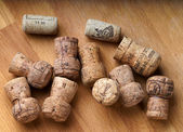 Bunch of wine corks on a wooden table. — Stock Photo
