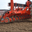 Stock Photo: Seeder in the field.