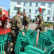 On a Victory Day holiday.Soldiers carry away chairs. - Stock Photo