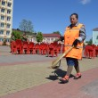 Постер, плакат: On streets of Slutsk Yard keepers clean a central square