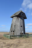 Remains of an old wooden windmill. — Stock Photo