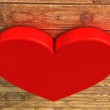 Red heart on wood — Stock Photo