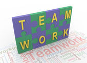 3d puzzle peaces with text 'teamwork' — Stock Photo