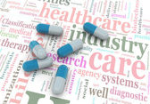 Pilules 3d sur wordcloud des soins de santé — Photo