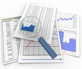 Magnifier on financial documents — Stock Photo