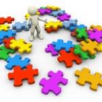 3d heap of puzzle peaces — Stock Photo #9554657