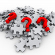 Stock Photo: 3d puzzle peaces and question mark