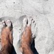 Legs in sand — Stock Photo