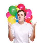 Happy young man with balloons — Stock Photo