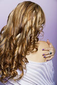 Long curly blond hair — Stock Photo