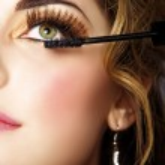 Woman with long eyelashes and mascara — Stock Photo
