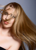 Woman with long blowing hair — Stock Photo