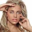Stock Photo: Tanned blond woman with long hair
