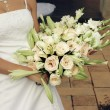 Stock Photo: Bride with cream roses and lilies